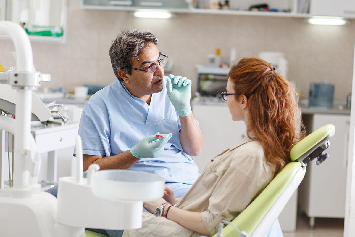 Senior male dentist in dental office
