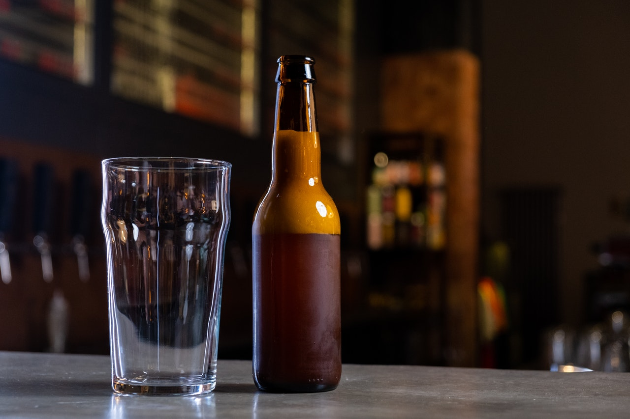 a beer bottle and a glass