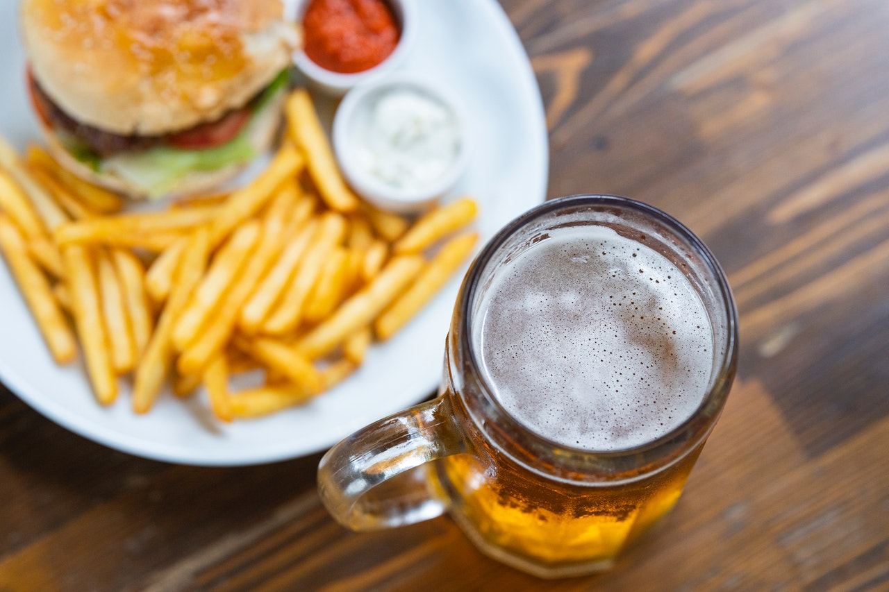 beer and hamburger with fries